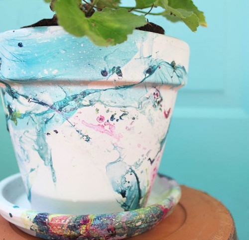 marble flower pot (via gina-michele)