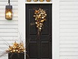 elegant Thanksgiving porch decor with metallic pumpkins and other veggies arranged, glitter and stenciled pumpkins on the steps is easy and bright