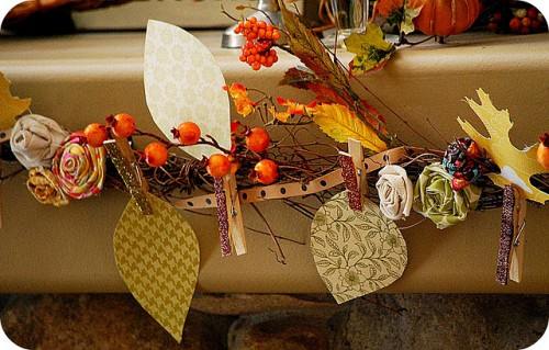 a vintage Thanksgiving garland of fabric leaves, blooms, berries and hearts is a stylish and refined decor idea