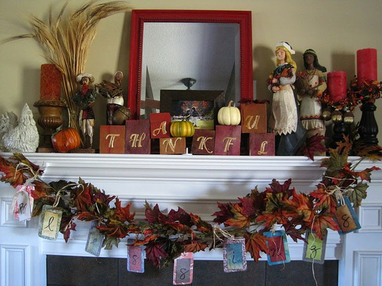 bright candles, wheat bundles, faux pumpkins, cubes and a lush faux leaf wreath with hanging