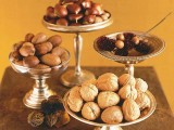 nuts, acorns and blooms in silver bowls on high stands is an elegant and chic fall centerpiece