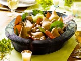 a bowl with pears, nuts, wheat and leaves is a nice fall or Thanksgiving idea of a centerpiece