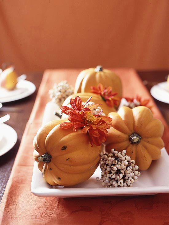 a porcelain tray with pumpkins, blooms and berries is an easy rustic centerpiece for the fall