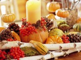 wooden branches, moss, berries, gourds, pumpkins, candles for a woodland Thanksgiving or fall centerpiece