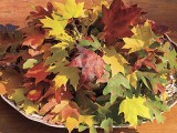 a bowl with bright fall leaves is an easy last-minute centerpiece for Thanksgiving