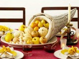 a cornucopia centerpiece with pumpkins, apples, pears, lemons and onions is a nice Thanksgiving centerpiece