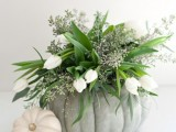 a grey heirloom pumpkin with greenery, eucalyptus and white tulips is a fresh and all-natural centerpiece for Thanksgiving