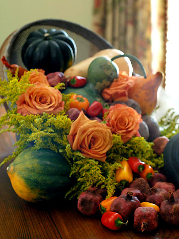 a lush harvest centerpiece of peppers, gourds, pomegranates, bright blooms and pumpkins is a bold idea to compose yourself