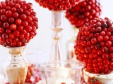 cranberry topiaries and candles can be used not only for a Christmas party but also for Thanksgiving