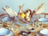 a glass bowl with corn cobs, pears and pumpkins is ideal for fall or Thanksgiving