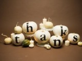neutral candles in candleholders, white pumpkins with THANKS letters to make a cool fall centerpiece