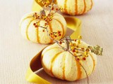 mini pumpkins and berries and a mustard ribbon is a stylish fall or Thanksgiving centerpiece