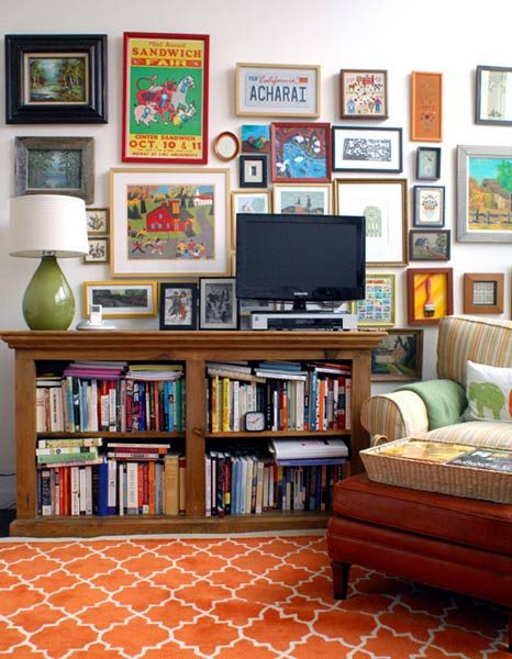 Tv Surrounded By Artwork