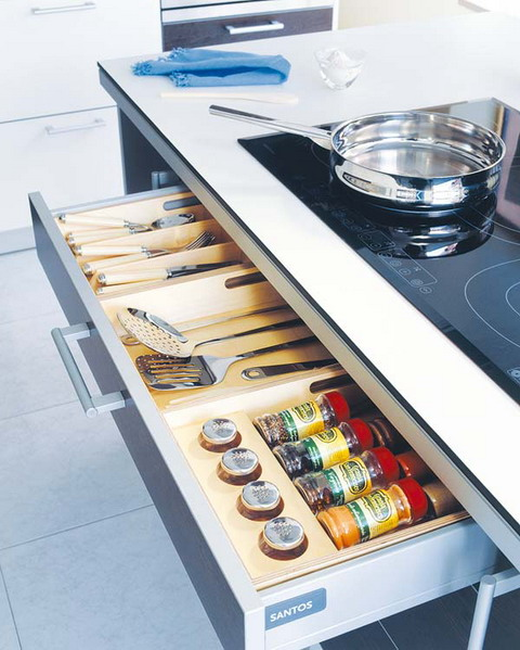 Under cooktop kitchen drawer is perfect for spices and utensils.