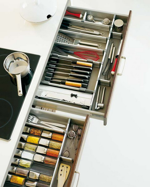 Lots of things could be organized right under your cooktop with several pull out drawers.
