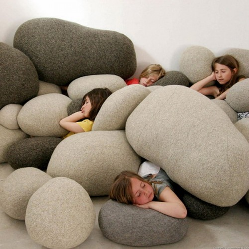 Fully functional sleeping area that consists of a bunch of floor pillows.