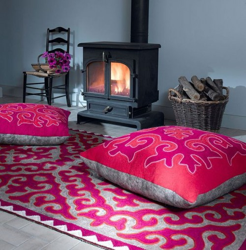 Floor pillows are more than welcome by the fireplace.