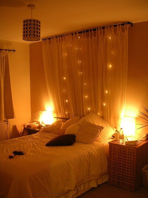 curtain headboard with lights (via simplyyourcreations)