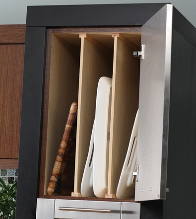 Vertical dividers in an upper cabinet to store trays and baking pans (via durasupreme)