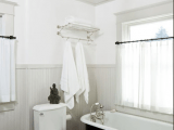 a neutral bathroom design with vintage touches