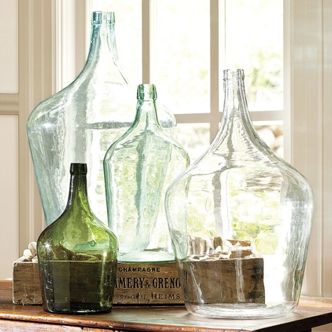 an arrangement of vintage bottles of various sizes and shapes is a chic and cool decoration to add a vintage feel to the space