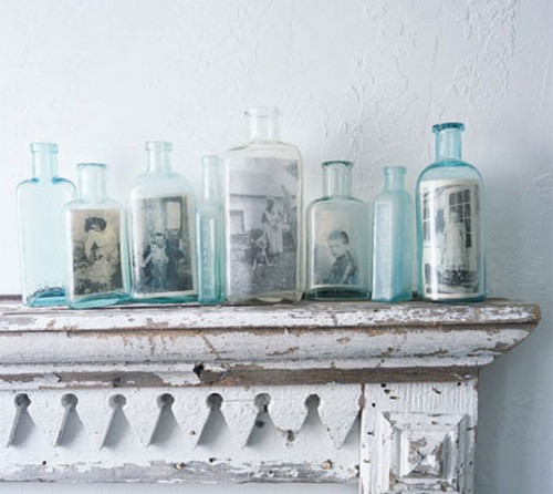 a shabby chic mantel with blue vintage bottles with photos is a very creative and cool gallery wall