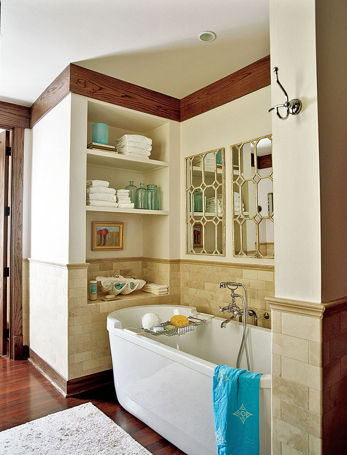 blue bottles on the shelf add color to the space and make the bathroom look catchy and more interesting
