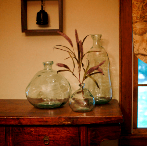 a modern decoration with irregular bottles with leaves and without is a cool idea for any interior