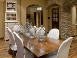 oversized neutral bottles placed on the table add interest to the vintage farmhouse space