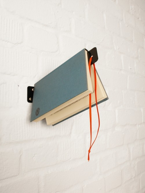 Creative Bookshelf That Also Serves As A Bookmark