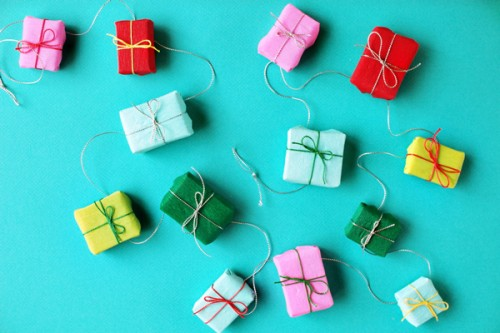 Cardboard strips and tissue paper could be turned into cute little presents you can hang anywhere you like. (via ohhappyday)