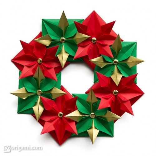 This traditional wreath is made of 8 folded square sheets of paper glued together. (via goorigami)