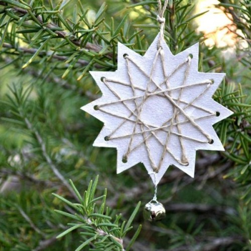 these unique stars are made from cereal box cardboard and embroidery thread pulled through it - Cardboard Box Christmas Decorations