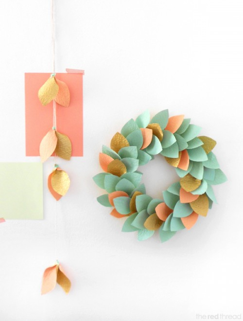 To make this wreath and garland you'll need some good wrapping paper. Although you could also upcycle magazines, old comic books, scrapbook paper, anything. The pieces of such paper should be glued to the cardboard base you can cut using simple plates. (via theredthreadblog)